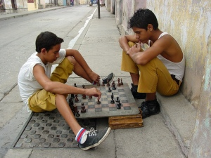 Boys playing chess in Santiago